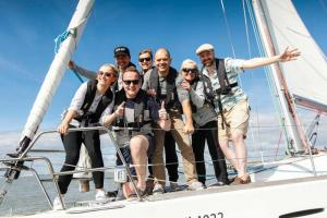 Sailing team pose